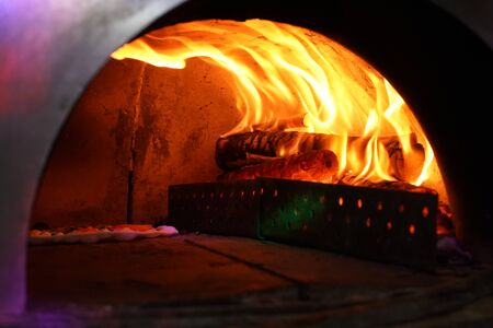 Vintage old Oven with fire inside for baking Original Pizza.