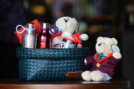 BANGKOK, THAILAND - 15 November, 2017: Starbuck souviniers and beverage arranged in the line on the wood table with blur background, to present the holiday gift to special preson.