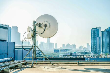 Industrial antenna at the building rooftop.