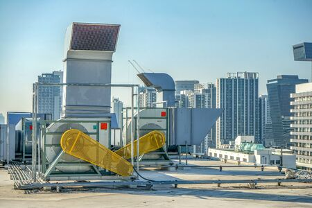 The industrial machine at the rooftop of the huge building. Stock Photo