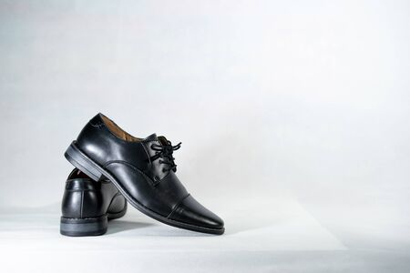 Luxuary man leather black shoe on the white isolation backtground.