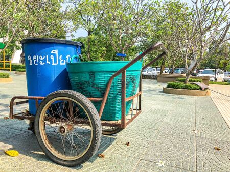 Wet Waste garbage plastic can on the three wheel Thailand local trolley parks in the park. Thai letter language text in picture means Wet Waste