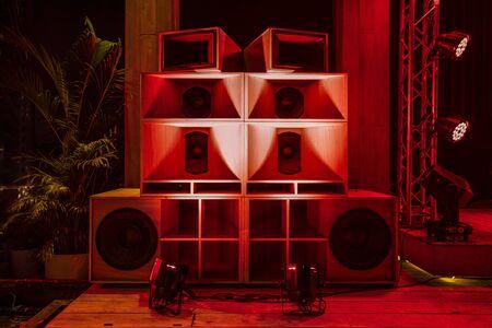 Big Wood Speaker Box set on the Hip Hop mini Concert stage with the LED red light. Reklamní fotografie