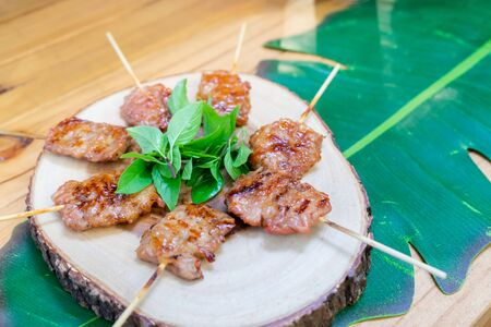 grilled pork Asia Thailand tranditional food and street food decorated on wood plate and banana leaf. It ready to eat.