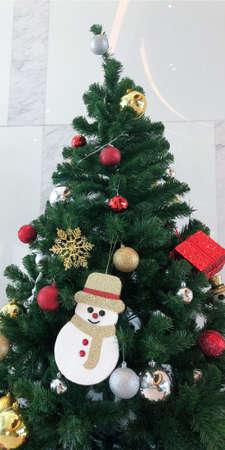 Christmas tree with snow man decoration. Stockfoto