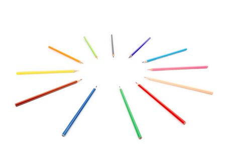 round radius and circle arrangement by blunt colour pencils directed and pointed to the center of the wheel. It has copy space on the white background for any text insertion.