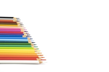 blunt colour pencils are arranged in the line on the white background and ready to paint.