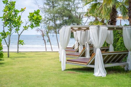 Relaxing square pavillon in the line on direction to the beach and sea in cozy tropical environment at Asia beach.