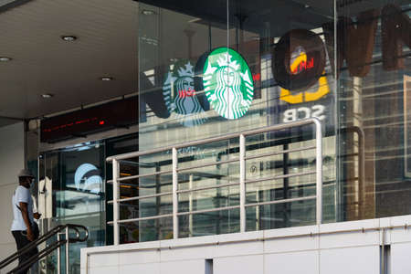 Bangkok, Thailand - 30 Apr 2020, The StarBucks retail still opens the light box logo in the COVID-19 period but It's out of any services and didn't clean mirror facade, Bangkok, Thailand.