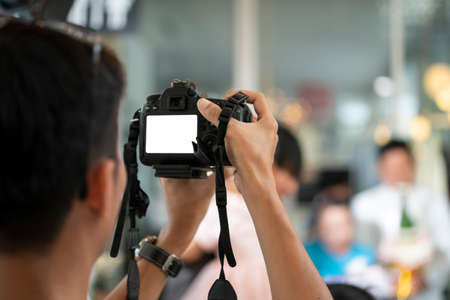 Videographer in the backside of camera are shooing and recording video in Wedding Event. Stockfoto