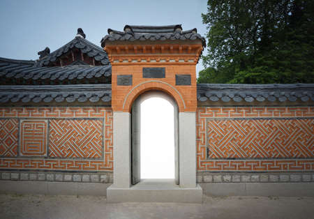 Korea Vintage Gateway and traditional vintage wall with the light inside the door.