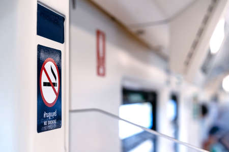 The No Smoking Sticker on the BTS train wall with blur background. (Texts on the sticker means