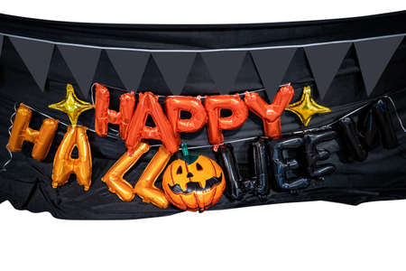 Happy Halloween orange balloon letters are prepared on the 2nd floor for hang on to the terrace with pumkin flag and black cloth background in Halloween party event.
