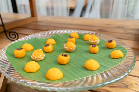 2 Traditional elegance Thai sweet desserts are JaMongKut (Chief Crown) and SaNayChan (Charming Moon). They are lucky and good fortune desserts in Thailand.