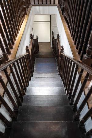 Dark brown Vintage wooden down stair perspective