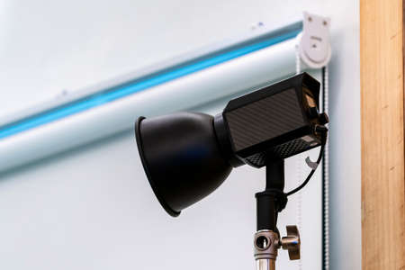 close up to Studio LED sportlight on tripod and standy in the event room.