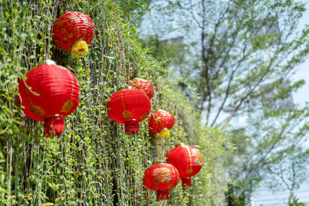 Traditional Chinese red lamps are hung for decoration in Chinese event.