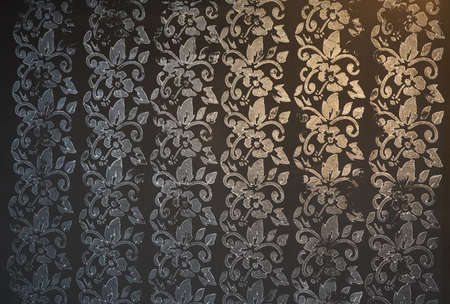 Gradient Gold and Silver Floral and foliage pattern in dark black background. 版權商用圖片