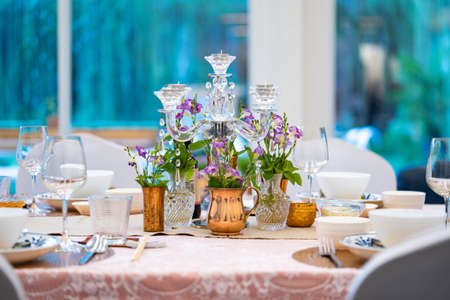 the luxury dinner set on the table with green and pink theme.