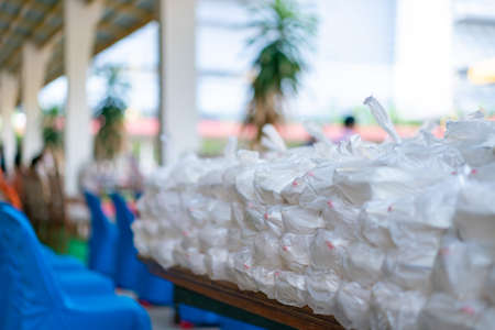 Asian foam food packages are prepare in plastic bag for donation to people.