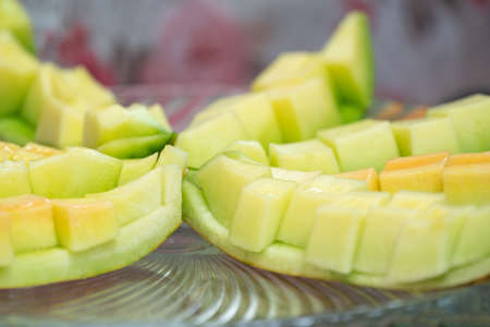 close up to the Green Cantaloupe was slided on the glass dish 版權商用圖片