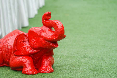 Asian Elephant statue figure sit and lay on the green turf