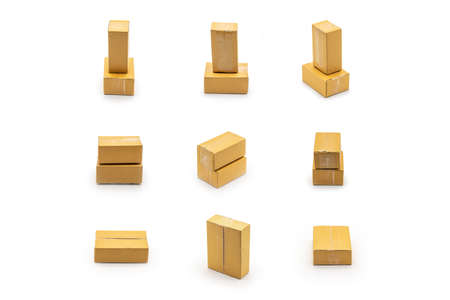 Isolated brown paper boxes postal package arranged in the studio light in front of white background from shopping online, is delivered to the buyer. Clipping Paths. 版權商用圖片