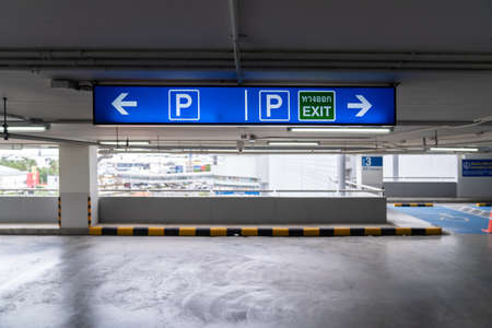 Signage Lightingbox in the indoor carparking, tell driver which way is parking lot or exit. Thai Language in green square on lightinbox means EXIT. 版權商用圖片