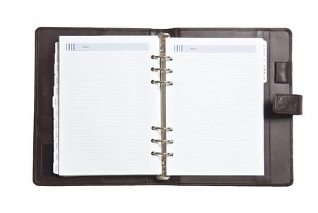 Bloc de notas en fondo blanco  Foto de archivo