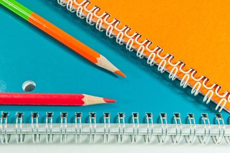 crayon and notebook close up Stock Photo