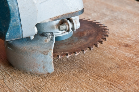 old circular saw blade on wood background Stock Photo