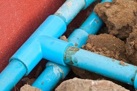 old blue pipe of the water work system photo