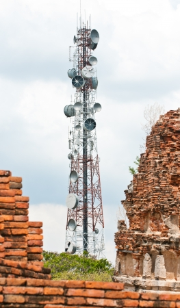 Steel telecommunication tower near old pagoda photo