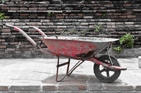 old red color construction wheelbarrow Stock Photo