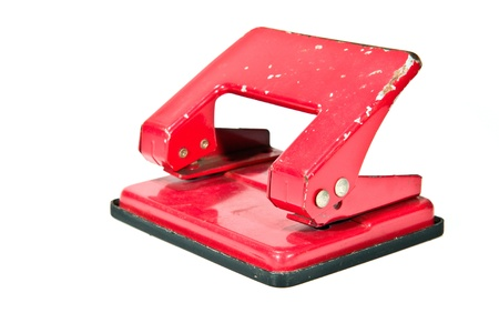 office equipment: old Red office paper hole puncher Stock Photo