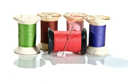 old Spool of thread and needle