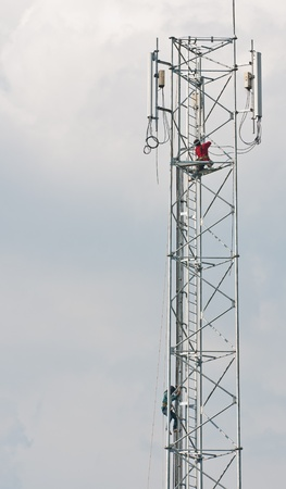 Technician working on communication towers
