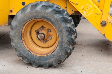 old Wheel of backhoe close up