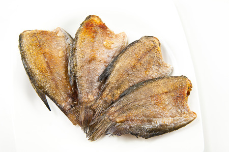 pectoralis: fried trichogaster pectoralis fish on white dish Stock Photo