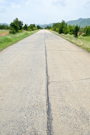 damaged cement: Damaged cement road outside the city