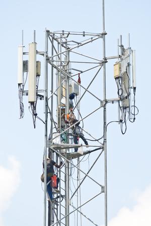 Technician working on communication towers photo