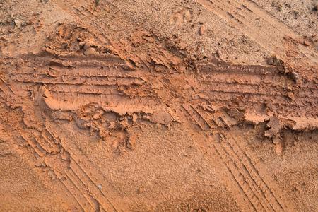 Tire tracks on the ground photo