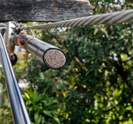 telephone cable: Copper telephone cable is cut on the pole. Stock Photo