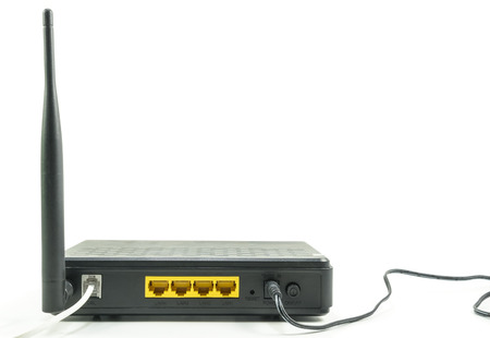black Wireless router with lan port isolated on white background
