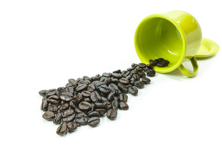 Dried beans falling from a coffee cup Stock Photo