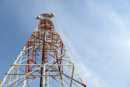 communication towers on blue sky background