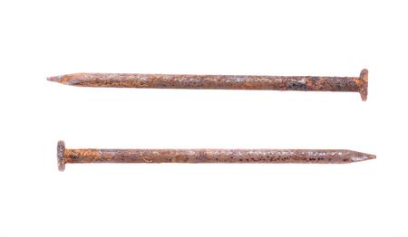 rusty nail: Clavo oxidado en el fondo blanco Foto de archivo