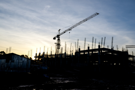 silhouettes of construction site and   cranes Stock Photo