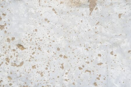 abstract background of ground on cement wall