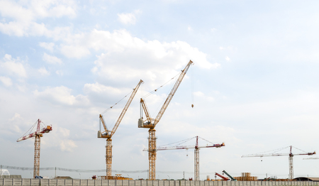 construction cranes on the sky background Stock Photo